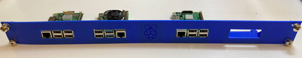 3D Printed Rack Mount Raspberry Pi with 3 Raspberry Pi's Mounted on it.